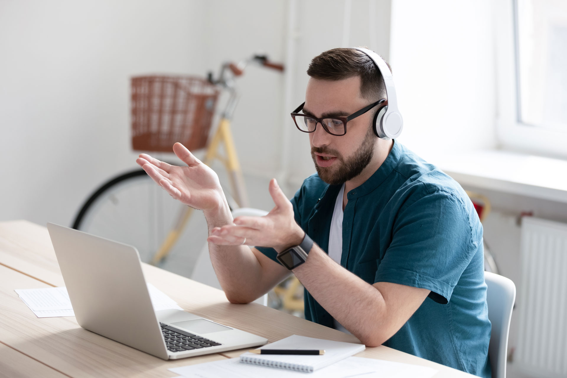 Man on video call with laptop at home